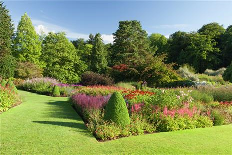 Manicured lawns and stunning flowerbeds blue sky