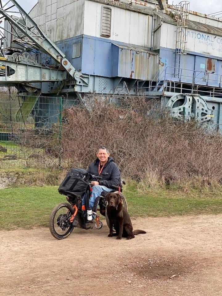 A wheelchair user with his dog at St Aidan's