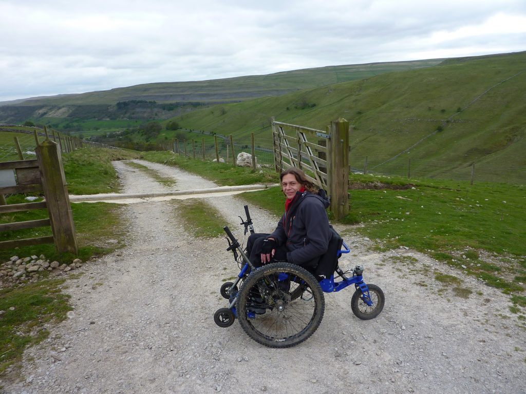 A Mountain Trike user on Great Whernside in the Yorkshire Dales.